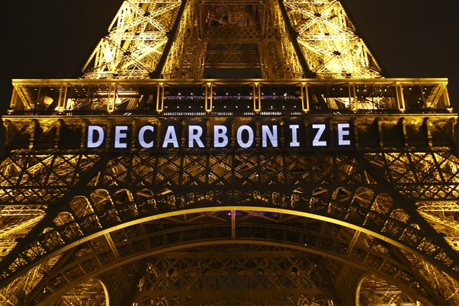 """The slogan """"DECARBONIZE"""" is projected on the Eiffel Tower as part of the COP21, United Nations Climate Change Conference in Paris, France, Friday, Dec. 11, 2015."""