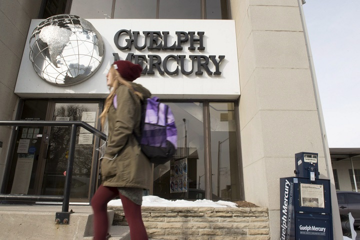 A woman walks by the Guelph Mercury office in Guelph, Ont. on Monday, Jan. 25, 2016. The Guelph Mercury daily newspaper has announced it will stop publishing its print editions this week with 23 full-time and three part-time jobs being affected.