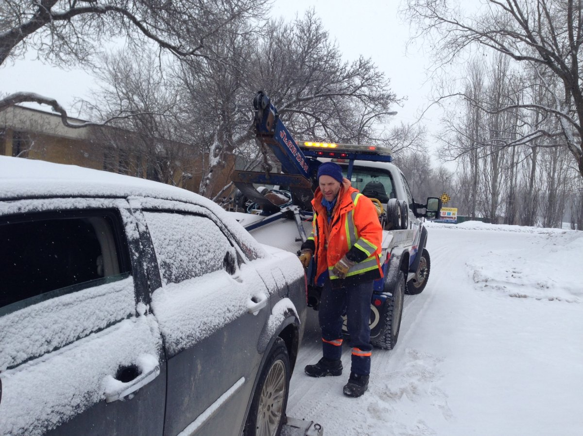 CAA driver works on hooking up a car Monday morning.