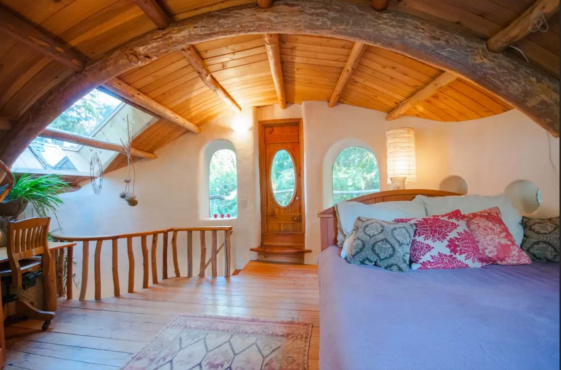 """This """"unique cob cottage"""" on Mayne Island in B.C. is """"a welcoming and cozy retreat hand sculpted of local, sustainable natural materials located on a lovely acreage with sheep, gardens and orchards.""""."""