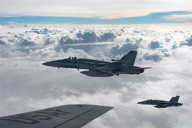 Royal Canadian Air Force CF-18 Hornets depart after refueling with a KC-135 Stratotanker assigned to the 340th Expeditionary Air Refueling Squadron, over Iraq.