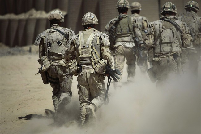 Canadian soldiers patrol southwest of Kandahar, Afghanistan, Monday, June 7, 2010.