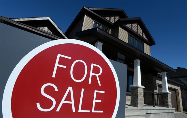 A sign advertises a new home for sale in Carleton Place, Ont., on March 17, 2015.