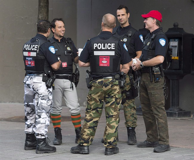 Montreal Police officers are shown on a street in Montreal on August 7, 2014.