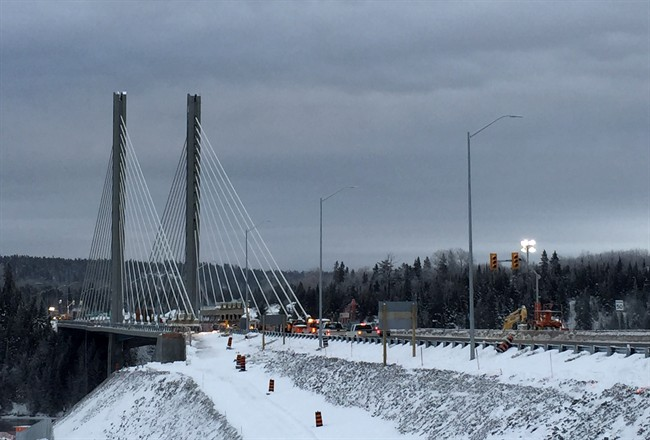 Works continues on the damaged Nipigon River Bridge in Nipigon, Ont., Thursday, Jan.14, 2016.