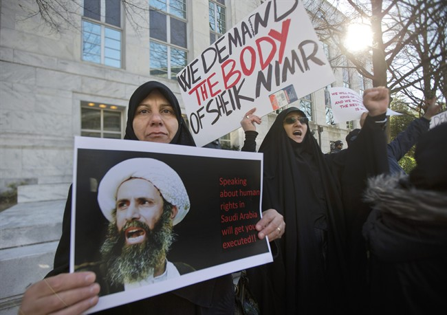 Amel Al-Hajjar, left, and Khadija Falih, both from Iraq, participate in a rally in front of the Saudi Arabian embassy in Washington, Tuesday, Jan. 5, 2016, to protest the mass executions in Saudi Arabia. Saudi Arabia executed last Saturday, Shiite cleric Sheikh Nimr al-Nimr and 46 others convicted of terror charges, the largest mass execution carried out by the kingdom since 1980.