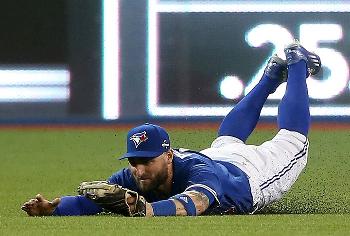 Kevin Pillar #11 of the Toronto Blue Jays makes a diving catch on a ball hit by Josh Hamilton #32 of the Texas Rangers in the fourth inning in game five of the American League Division Series at Rogers Centre on October 14, 2015 in Toronto, Canada. (Photo by Tom Szczerbowski/Getty Images).
