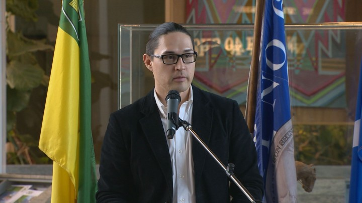 Matthew Dunn, Indigenous Peoples Initiatives Coordinator with the College of Engineering, speaks in front of a crowd at the University of Saskatchewan.