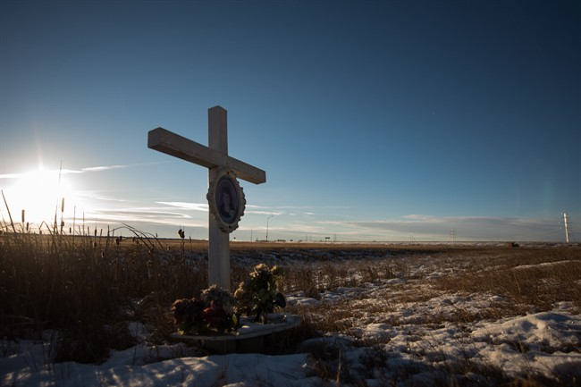 A memorial to a previous crash marks the intersection at Wanuskewin Rd and Highway 11, outside of Saskatoon. The intersection was the scene of tragedy where a family of four were killed in a collision with an SUV Sunday morning.