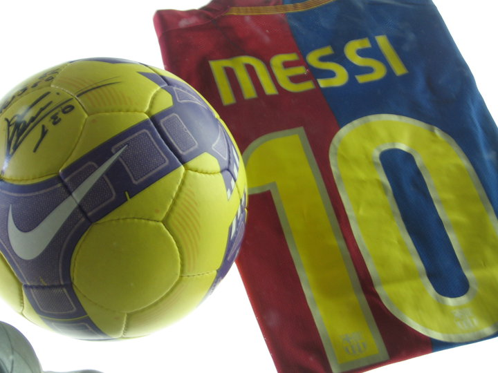 Lionel Messi Jersey and signed Ball inside the Camp Nou museum & stadium.