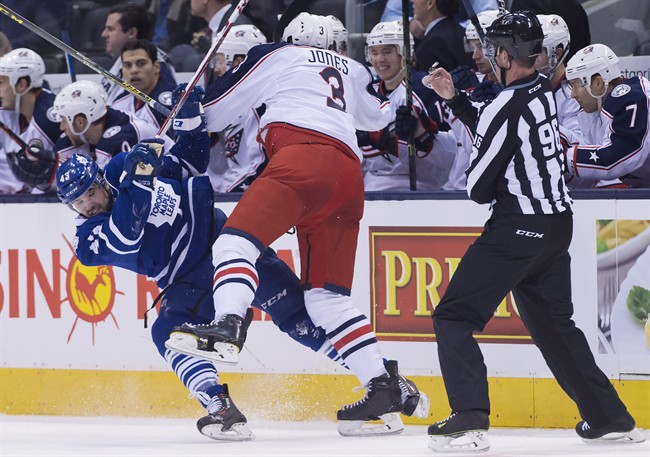 Toronto Maple Leafs centre Nazem Kadri (43) gets hit by Columbus Blue Jackets defenceman Seth Jones (3) during second period NHL hockey action in Toronto on Wednesday, January 13, 2016.