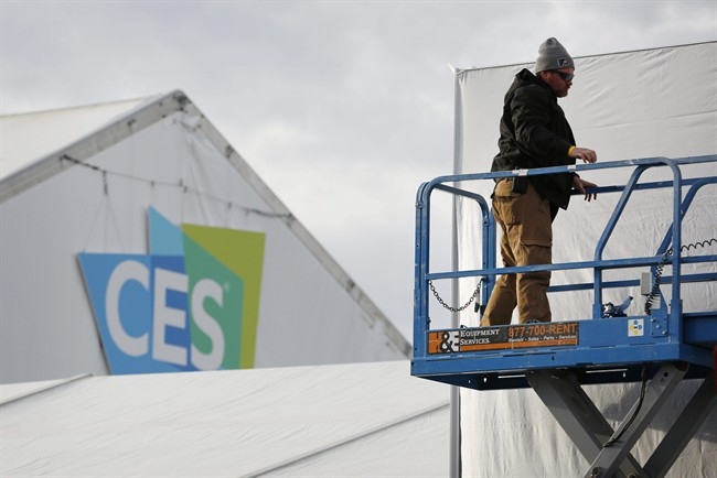A worker helps prepare a temporary structure in preparation for the International CES gadget show Sunday, Jan. 3, 2016, in Las Vegas. The show officially kicks off Wednesday, Jan. 6.