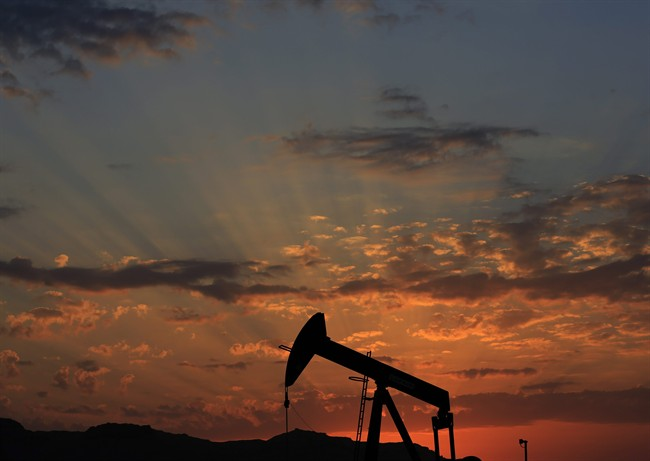 FILE - In this Dec. 13, 2015 file photo the sun sets behind an oil pump in the desert oil fields of Sakhir, Bahrain. Oil futures spiked briefly on Monday, Jan. 4, 2016, after the news that Saudi Arabia would cut diplomatic ties with Iran, a development that could be seen as a threat to oil supplies. Investors quickly discounted those fears, however.