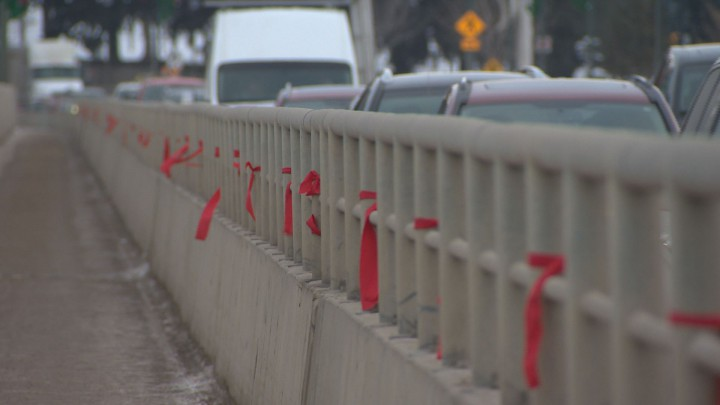 Red ribbons were tied to the University Bridge in Saskatoon Tuesday, meant to raise awareness for missing and murdered indigenous women in Canada.