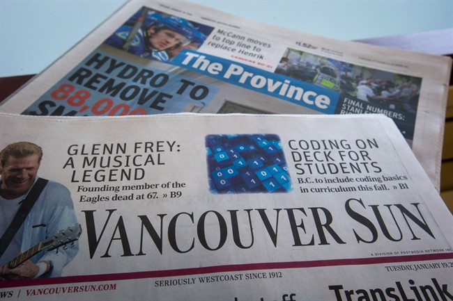 Copies of Postmedia-owned newspapers the Vancouver Sun and Province are displayed at a store in Burnaby, B.C., on Tuesday January 19, 2016.