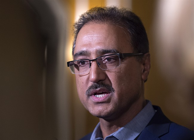 Federal Infrastructure Minister Amarjeet Sohi talks with reporters at a cabinet retreat at the Algonquin Resort in St. Andrews, N.B. on Sunday, Jan. 17, 2016.