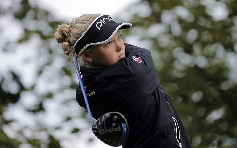 Brooke Henderson of Canada plays on the 15th hole during the second round of the Evian Championship women's golf tournament in Evian, eastern France, Friday, Sept. 11, 2015.