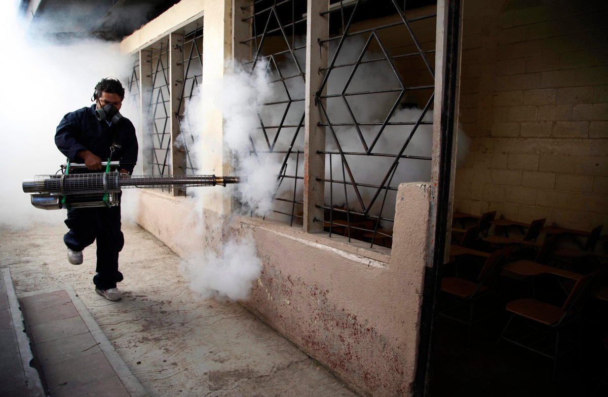 A city worker fumigates a public school to combat the Aedes aegypti mosquito, known to transmit dengue, Chikungunya and Zika, in Tegucigalpa, Honduras.