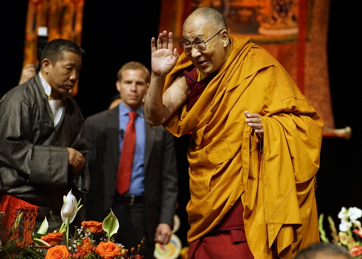 The Dalai Lama address the audience at the Minneapolis Convention Center on Sunday, Feb. 21, 2016 in Minneapolis.