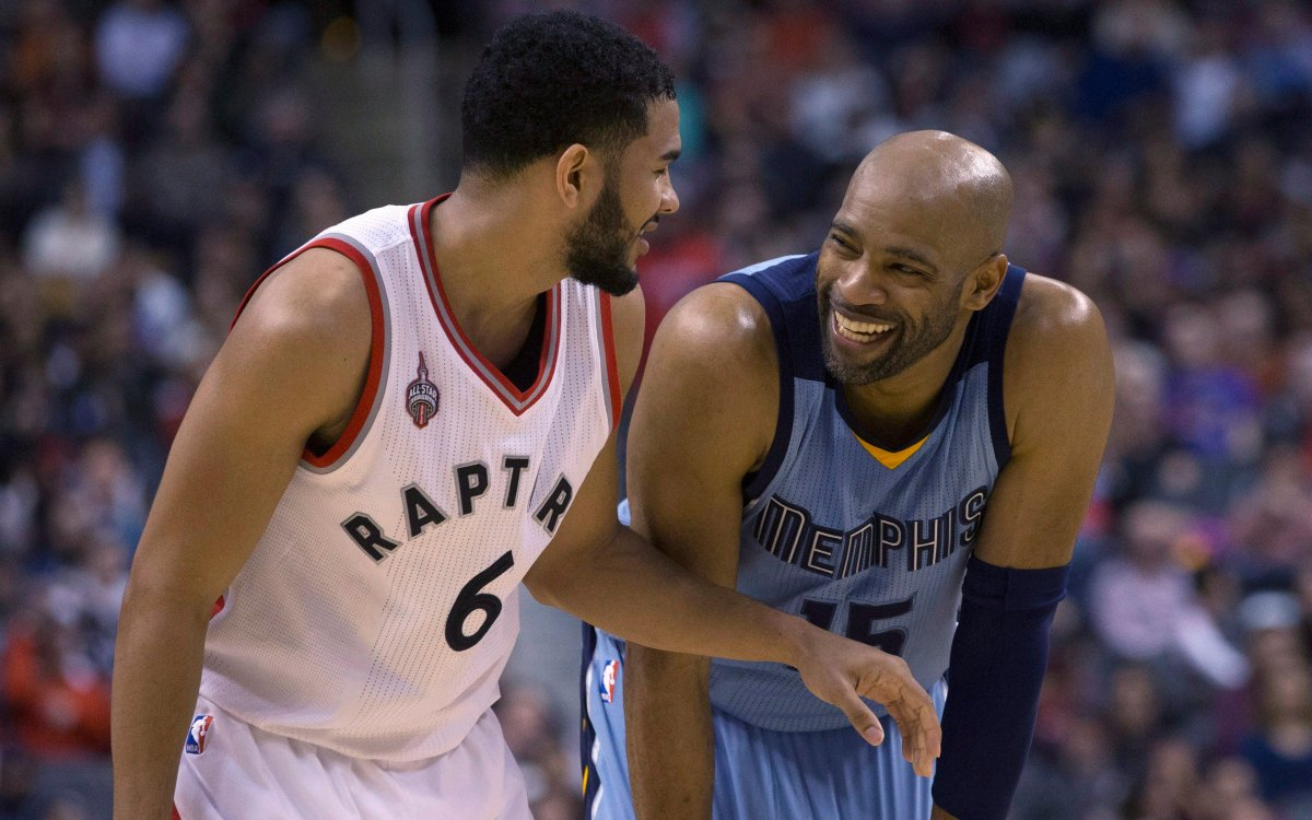 Toronto Raptors' Cory Joseph shares a joke with Memphis Grizzlies' Vince Carter during second half NBA basketball action in Toronto on Sunday, February 21, 2016.