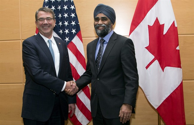 U.S. Secretary of Defense Ash Carter, left, shakes hands with Canadian Defence Minister Harjit Singh Sajjan prior to a bilateral meeting at NATO headquarters in Brussels on Wednesday, Feb. 10, 2016.