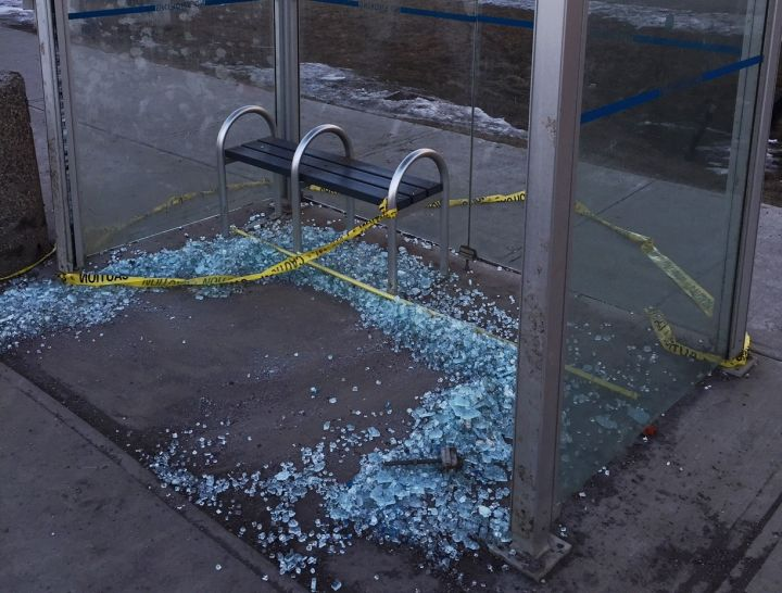 A bus shelter with its glass shattered on 50 Street.