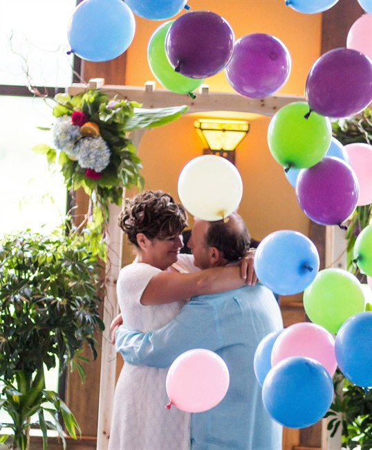 Maurice Robichaud and Patricia Galbraith embrace at their wedding in the summer of 2015 in a handout photo.