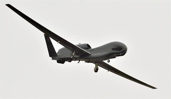 A U.S. Global Hawk surveillance drone prepares to land at the Misawa Air Base in Misawa, northern Japan, Saturday, May 24, 2014.
