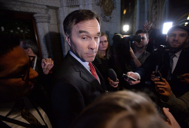 Finance Minister Bill Morneau speaks to reporters following a Liberal cabinet meeting on Parliament Hill in Ottawa on Tuesday, Feb. 2, 2016.