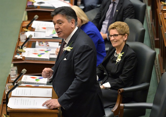 Ontario Finance Minister Charles Sousa, left, delivers the Ontario 2016 budget next to Premier Kathleen Wynne, right, at Queen's Park in Toronto on Thursday, February 25, 2016.