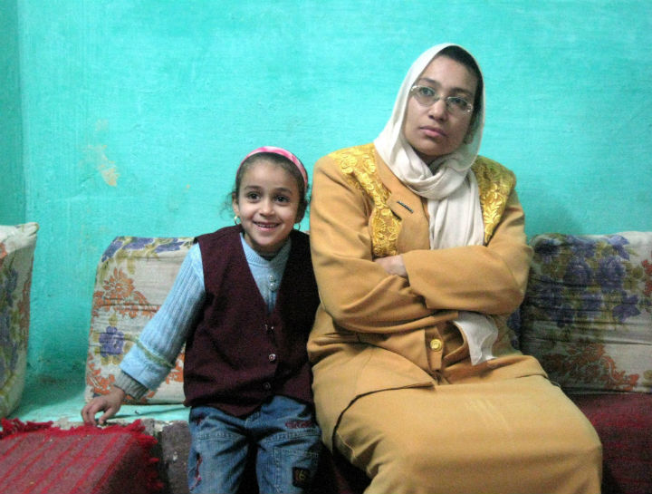 Maha Mohammed, right, and her daughter Rehab, left, listen to workers from a local rights group, not pictured, who explain the dangers of female circumcision during a visit to Mohammed's home in the Egyptian village of Sultan Zawyit on Dec. 5, 2015. (File photo).