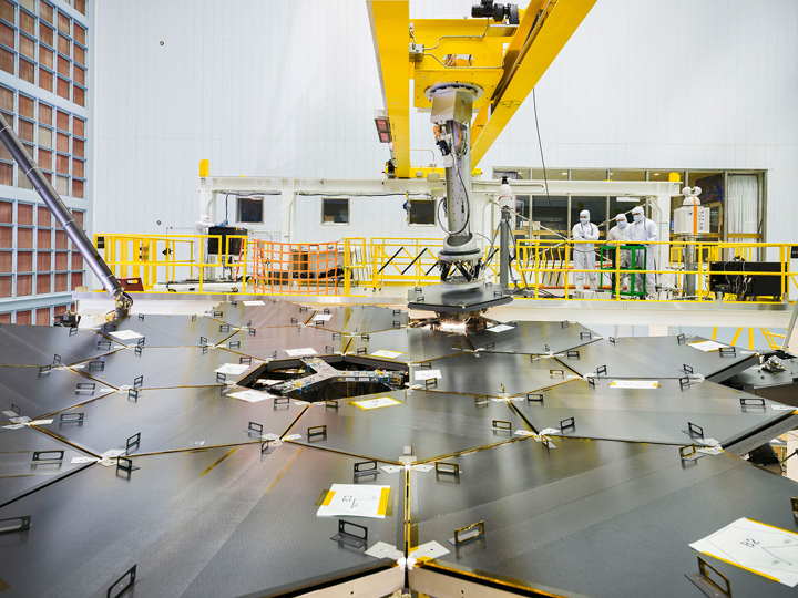 Inside a massive clean room at NASA's Goddard Space Flight Center in Greenbelt, Maryland the James Webb Space Telescope team used a robotic am to install the last of the telescope's 18 mirrors onto the telescope structure.