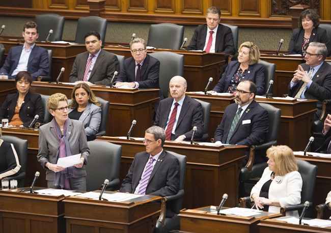 Ontario Premier Kathleen Wynne, bottom left, speaks during question period at Queen's Park in Toronto on Monday, February 22, 2016. THE CANADIAN PRESS/Nathan Denette.