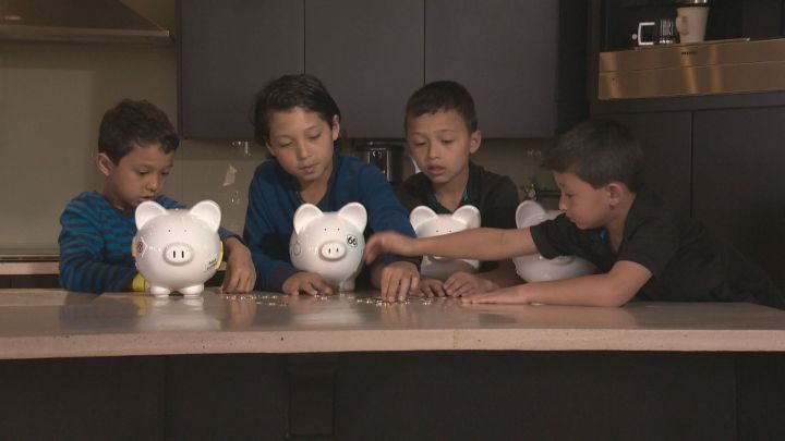 As sons of a financial expert, the Yih boys learn to save money using piggy banks and bank accounts.