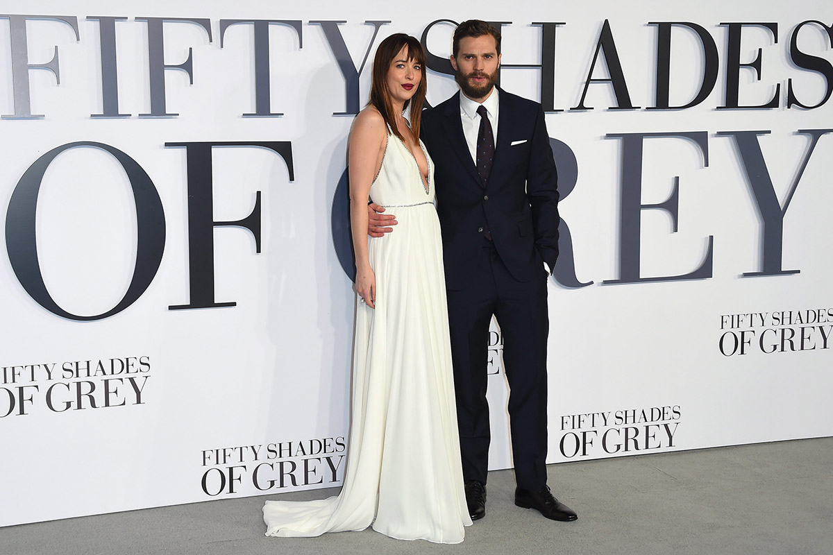 The dynamic duo, Dakota Johnson and Jamie Dornan, pose for photographers at the UK Premiere of Fifty Shades of Grey.