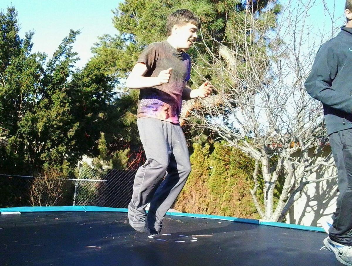 A person jumping on a trampoline.