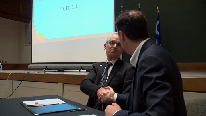 University of Saskatchewan president Peter Stoicheff (left) and Ry Moran, director of the National Centre for Truth and Reconciliation, shake hands as the U of S joins eight other post-secondary institutions in partnering with the centre.