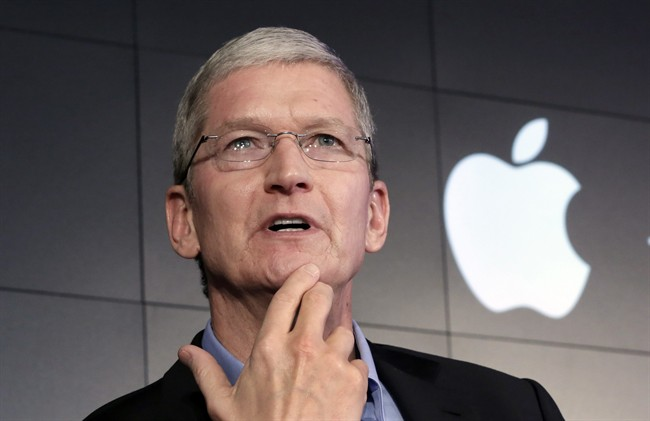 """Apple CEO Tim Cook responds to a question during a news conference in New York. Apple Inc. on Thursday asked a federal magistrate to reverse her order that the company help the FBI hack into a locked iPhone, accusing the federal government of seeking """"dangerous power"""" through the courts."""