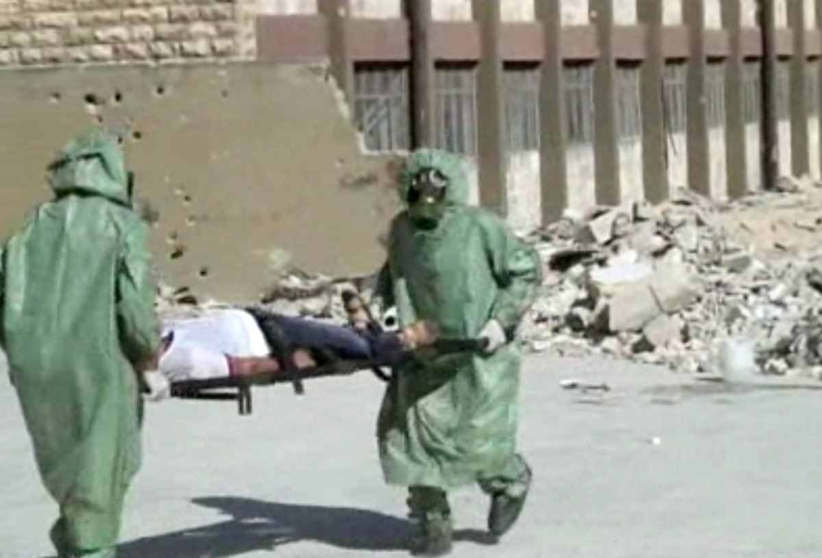 This image made from an AP video posted on Wednesday, Sept. 18, 2013 shows shows Syrians in protective suits and gas masks conducting a drill on how to treat casualties of a chemical weapons attack in Aleppo, Syria. The Islamic State group is aggressively pursuing development of chemical weapons, setting up a branch dedicated to research and experiments with the help of scientists from Iraq, Syria and elsewhere in the region, according to Iraqi and U.S. intelligence officials.