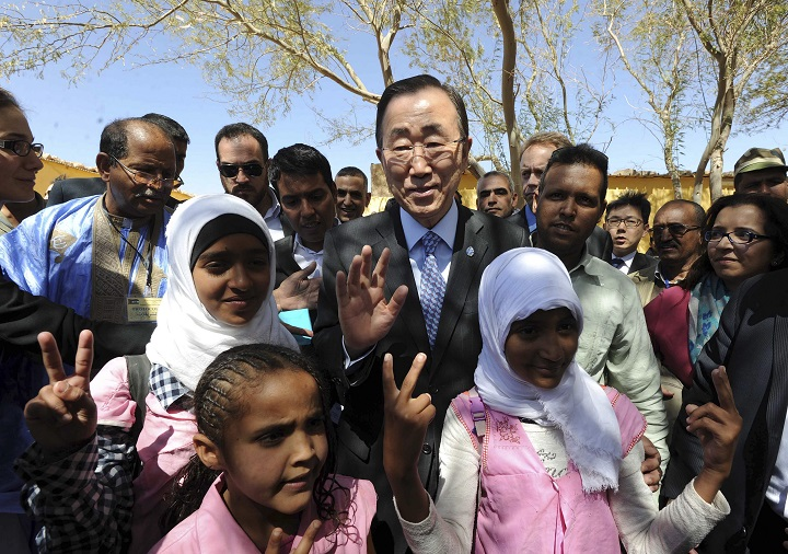 United Nations secretary-general Ban Ki-moon poses with children as he visits the Smara refugees camp near Tindouf, south-western Algeria, Saturday, March 5, 2016.