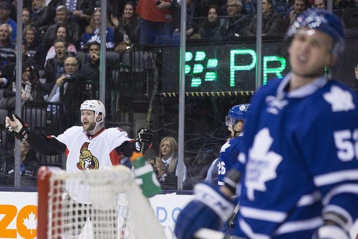 Ottawa Senators' Zack Smith, left, celebrates scoring the game-winning goal against Toronto Maple Leafs during third period NHL hockey action in Toronto on Saturday March 5, 2016.