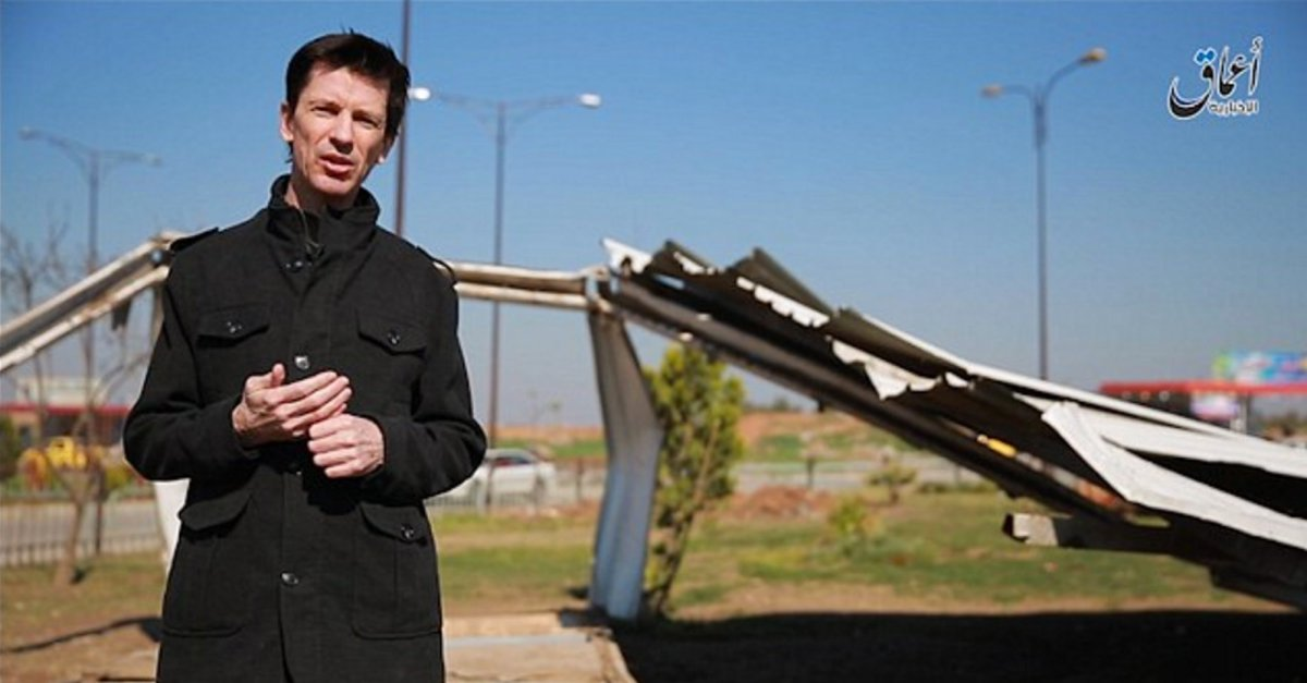 This photo posted online by the Islamic State group-affiliated Amaq News Agency on Friday, March 18, 2016 shows British journalist John Cantlie, who is being held hostage by the militants, during a stand-up for an IS propaganda video in Mosul, Iraq. It is the first video featuring Cantlie to be released by the group since February 2015 when he appeared purportedly from Syria's Aleppo province.
