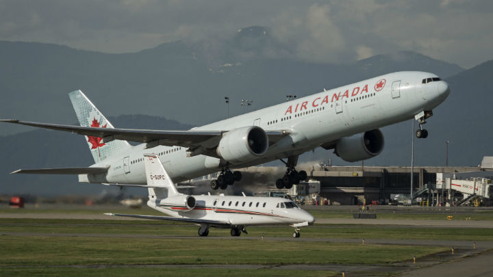 An Air Canada Boeing 777-300ER wide-body jetliner takes off from Vancouver International Airport, Richmond, B.C. on Feb. 16. (File photo).