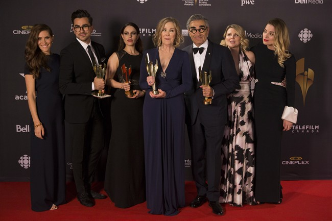 Cast members from 'Schists Creek' hold their multiple awards at the Canadian Screen Awards in Toronto on Sunday evening, March 13, 2016. THE CANADIAN PRESS/Chris Young.