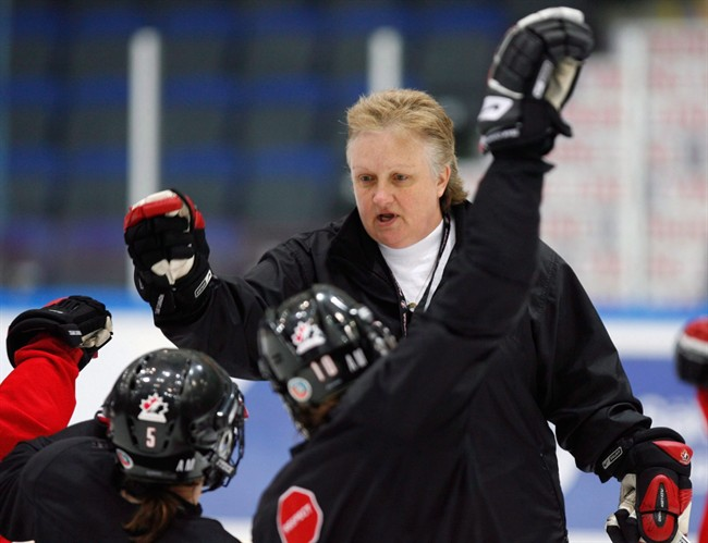 Team Canada head coach Melody Davidson gives high-fives to players at the end of practice at the World Women Hockey Championship Thursday, April 9, 2009 in Hameenlinna, Finland.