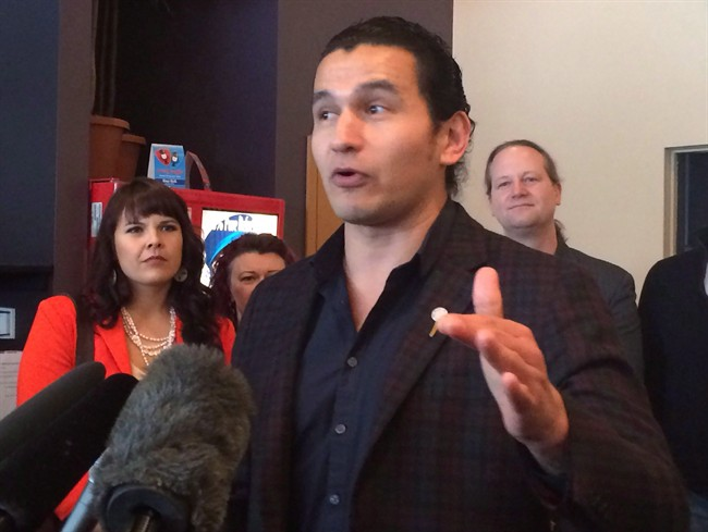 Wab Kinew is facing questions about lyrics he wrote and performed that are demeaning to women and gays and lesbians.
