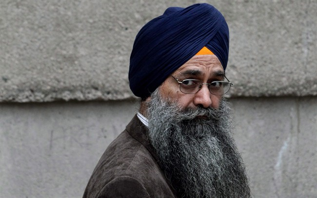 Inderjit Singh Reyat, the only man ever convicted in the Air India bombings of 1985, waits outside B.C. Supreme Court in Vancouver on Friday, September 10, 2010.