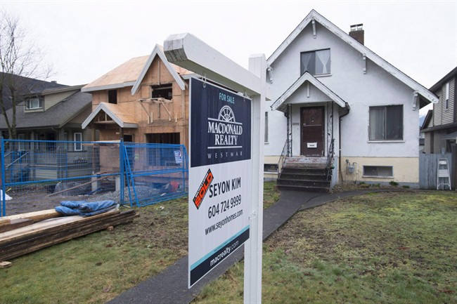 A sold home is pictured in Vancouver, B.C., Thursday, Feb. 11, 2016.