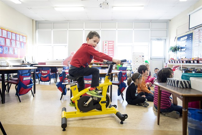 Andrew Tilley, 5, rides a stationary bike during a lesson in teacher Mary Theresa Burt's classroom at Ian Forsyth Elementary School in Dartmouth, N.S. on Monday, March 7, 2016.