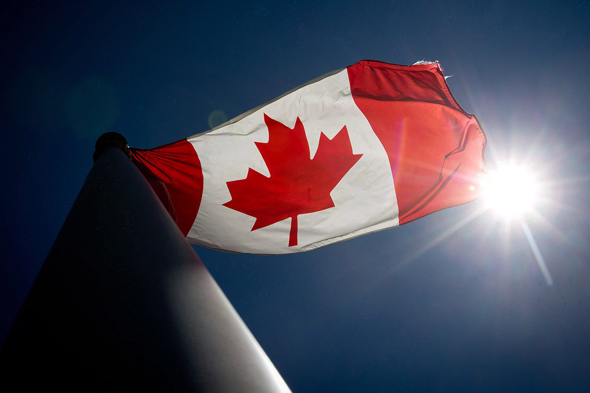 A Canadian flag flies in the wind at Granville Island in Vancouver, B.C., on Monday June 30, 2014.